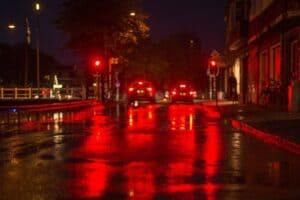 tail lights on a rainy street at night