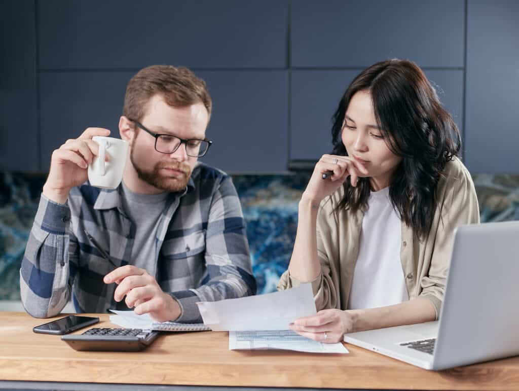 Couple reviewing Roof Financing Options