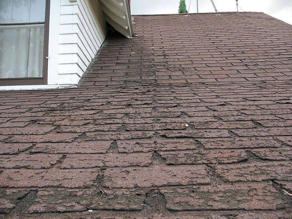 signs of roof damage on shingles near eave
